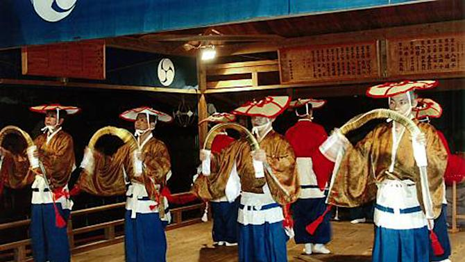 In this undated photo released by Cultural Heritage Division of Wakayama Prefectural Board of Education, dancers perform Nachi no Dengaku, a religious performing art, during the annual Nachi fire festival at Kumano Nachi Shrine in Nachikatsuura, Wakayama Prefecture, central Japan. (AP Photo/Wakayama Prefectural Board of Education) EDITORIAL USE ONLY