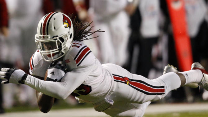 Louisville cornerback Terell Floyd (19) intercepts a Rutgers pass to seal the win with about a minute left in an NCAA college football game in Piscataway, N.J., Thursday, Nov. 29, 2012. Louisville won 20-17. (AP Photo/Mel Evans)