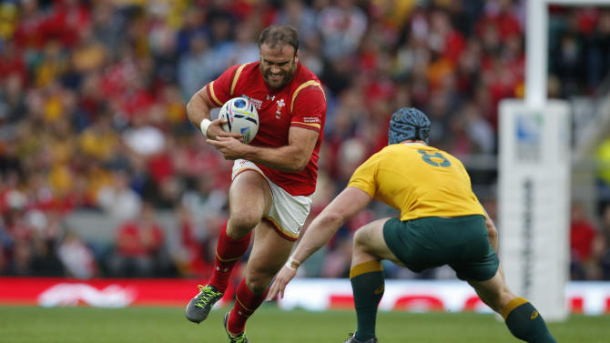 Australia's David Pocock goes to tackle Wales' Jamie Roberts during the Rugby World Cup Pool A match between Australia and Wales at Twickenham Stadium, London, Saturday, Oct. 10, 2015. (AP Photo/Christophe Ena)