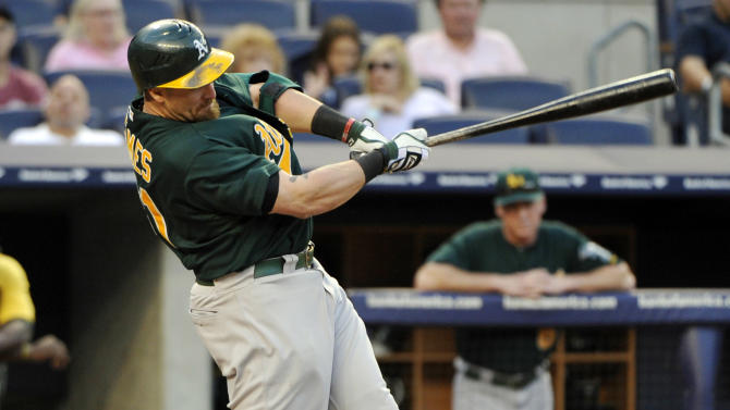 Oakland Athletics' Jonny Gomes hits a two-run home run during the 13th inning of a baseball game against the New York Yankees, Saturday, Sept. 22, 2012, at Yankee Stadium in New York. (AP Photo/Bill Kostroun)