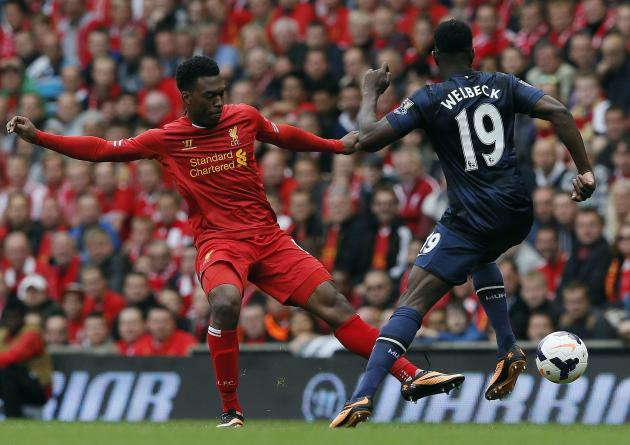Liverpool's Sturridge fights for the ball with Manchester United's Danny Welbeck during their English Premier League soccer match at Anfield
