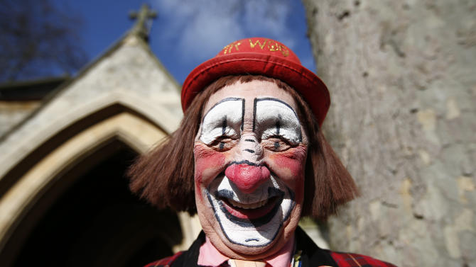 "The clown ""Mr. Woo"" arrives at the All Saints Church before the Grimaldi clown service in Dalston, north London"