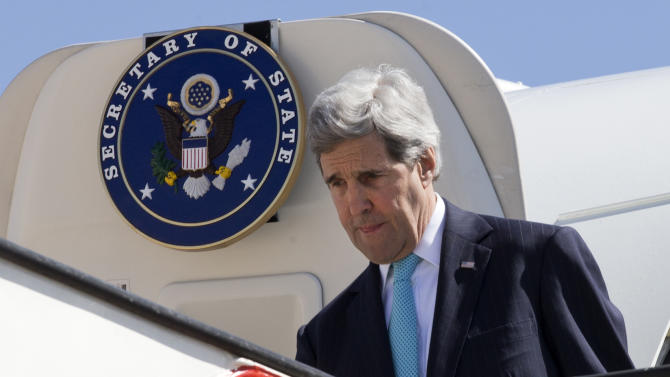 U.S. Secretary of State John Kerry arrives in Amman, Jordan on Wednesday, March 26, 2014. Kerry arrived in Jordan in hopes of jump-starting foundering Mideast peace talks just as Arab leaders released a communique saying they will never recognize Israel as a Jewish state. (AP Photo/Jacquelyn Martin, Pool)