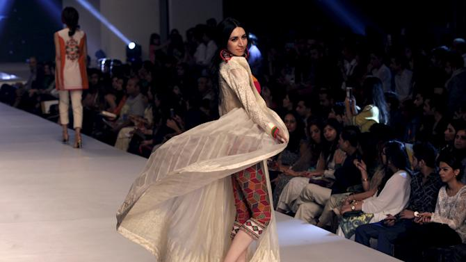 Models present creations by Pakistani designer Hina Butt during Pakistan Fashion Design Council (PFDC) Fashion Week in Lahore