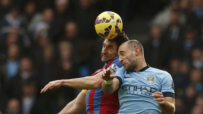 Manchester City's Pablo Zabaleta challenges Crystal Palace's Mile Jedinak during their English Premier League soccer match at the Etihad Stadium in Manchester