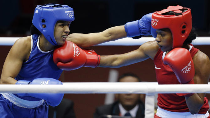 Venezuela's Karlha Magliocco, left, and Brazil's Erica Matos, fight during the women's flyweight boxing competition at the 2012 Summer Olympics, Sunday, Aug. 5, 2012, in London. (AP Photo/Patrick Semansky)