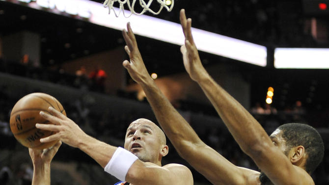 New York Knicks' Jason Kidd (5) shoots over San Antonio Spurs' Tim Duncan, right, during the first half of an NBA basketball game on Thursday, Nov. 15, 2012, in San Antonio. (AP Photo/Darren Abate)