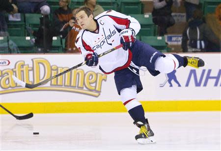 Capitals' Ovechkin takes part in pre-game warm-ups before the start of their NHL pre-season hockey game against the Jets in Belleville
