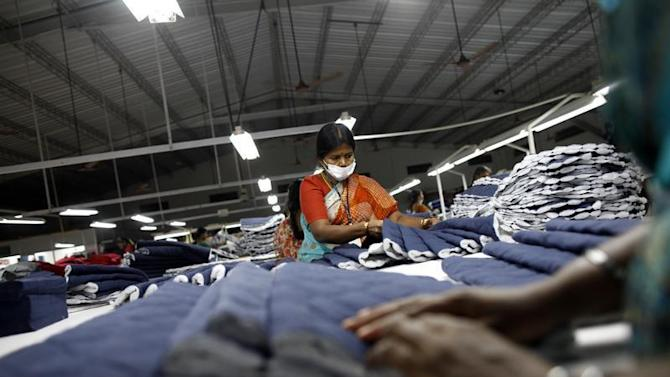 Employees sort pieces of cloth at the Estee garment factory in Tirupur