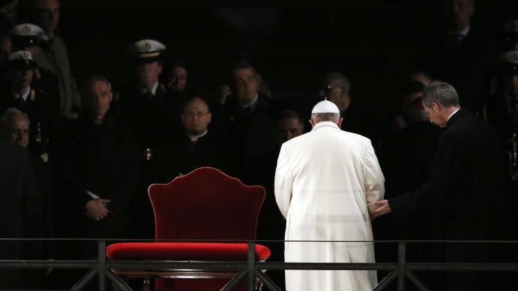 Pope Francis leaves at the end of the Via Crucis (Way of the Cross) procession during Good Friday celebrations in front of the Colosseum in Rome