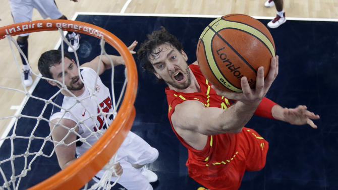 In this Aug. 12, 2012, file photo, Spain's Pau Gasol, right, drives past United States' Kevin Love, left, to score during the men's gold medal basketball game at the 2012 Summer Olympics in London.  The U.S. national team, without LeBron James, Kevin Durant, Kevin Love and Paul George,  is good enough to win the FIBA Basketball World Cup but vulnerable enough to lose. One team that could beat the Americans is Spain, which gave the U.S. close games in the last two Olympics and now is home