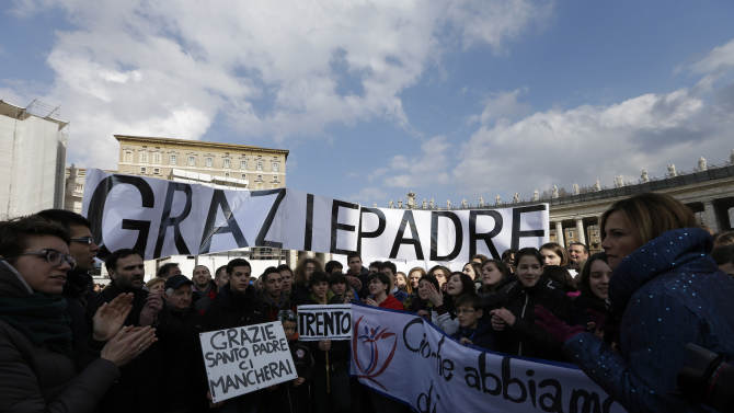 "Faithful from Trento, northern Italy, hold up signs in Italian reading ""Grazie Padre"" (Thank you Father) and ""Grazie Santo Padre ci mancherai"" (Thank you Holy Father we will miss you) prior to Pope Benedict XVI's last Angelus noon prayer, in St. Peter's Square, at the Vatican, Sunday, Feb. 24, 2013. The last chance for a Sunday blessing from Pope Benedict XVI from his studio window is drawing a crowd to St. Peter's Square. Benedict, 85, steps down on Thursday, the first pontiff to resign in 600 years. He'll hold his last public audience in the square on Wednesday. (AP Photo/Alessandra Tarantino)"