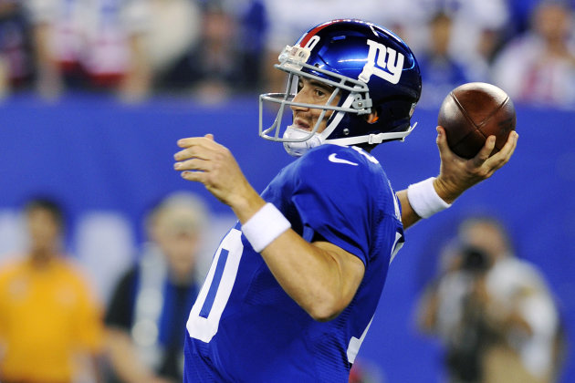 New York Giants quarterback Eli Manning (10) throws a pass during the first half of an NFL football game against the Dallas Cowboys, Wednesday, Sept. 5, 2012, in East Rutherford, N.J. (AP Photo/Bill Kostroun)