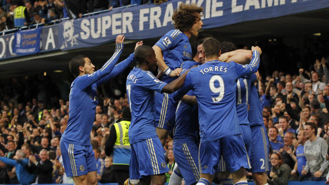 Chelsea players celebrate Oscar's goal against Tottenham Hotspur with teammates during their English Premier League soccer match at Stamford Bridge, London, Wednesday, May 8, 2013. (AP Photo/Sang Tan)