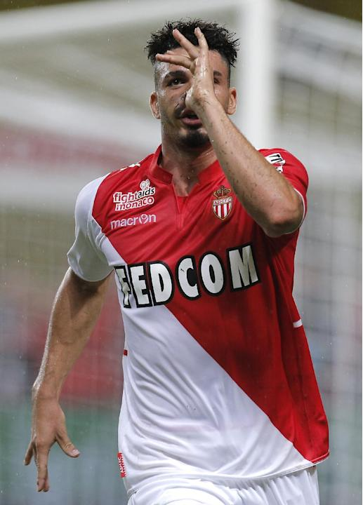 Monaco's Emmanuel Riviere of France reacts after scoring the first goal during the French League One soccer match against Bastia in Monaco stadium, Wednesday, Sept, 25, 2013