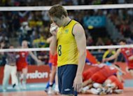 Brazil&#39;s Murilo Endres leaves in dejection after losing to Russia in the men&#39;s volleyball gold medal match of the London 2012 Olympics Games on August 12. Russia looked down and out at two sets to love and 22-19 down in the third, but with the title just three points away, Brazil collapsed