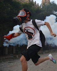 An Egyptian protester runs with a tear gas canister to throw back at the riot police during clashes near the US embassy in Cairo. As anti-American protests erupt in the Muslim world, the United States is powerless to act against those who incited the violence due to the freedoms enshrined in its cherished constitution