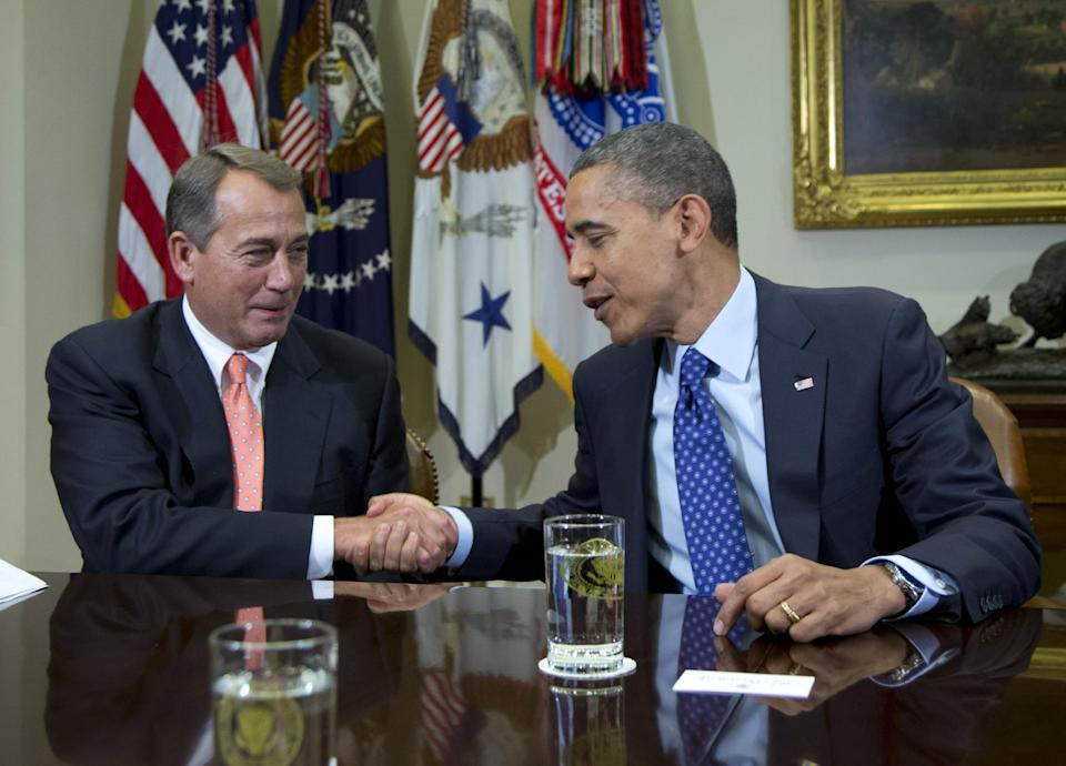 President Barack Obama shakes hands with House Speaker John Boehner of Ohio in the Roosevelt Room of the White House in Washington, Friday, Nov. 16, 2012, during a meeting to discuss the deficit and economy.  (AP Photo/Carolyn Kaster)