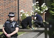 British police carry out a search of the front garden at the home of Saad and Iqbal al-Hilli in Claygate, in Surrey, southeast England, on September 13. British police have hailed &quot;extremely productive&quot; talks with the French prosecutor and the judge leading the probe into the killing of a British family in the French Alps last week