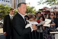 "Actor Tom Hanks signs autographs at the ""Cloud Atlas"" premiere during the 2012 Toronto International Film Festival on September 8, 2012"