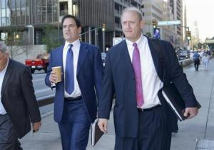 Cuban, the billionaire owner of the NBA's Dallas Mavericks, and his attorney Best approach U.S District Court for the opening day of his insider trading trial in Dallas