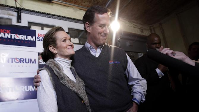 "FILE - In this March 30, 2012 file photo, then-Republican presidential candidate, former Pennsylvania Sen. Rick Santorum is joined by his wife Karen as he talks to reporters in Chippewa Falls, Wis. The Republican primary campaign is already fading into memory. Remember Herman Cain's 9-9-9 tax plan? Newt Gingrich's ""moon base"" proposal? Or Rick Perry's ""oops"" moment _ when he couldn't recall that third federal agency he wanted to eliminate?  (AP Photo/Jae C. Hong, File)"