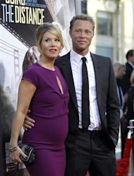 "Cast member Christina Applegate and her fiance Dutch bass player Martyn Lenoble pose at the premiere of ""Going the Distance"" in Hollywood, California August 23, 2010. REUTERS/Mario Anzuoni/Files"