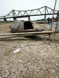 A small boat lies on the bed of the Red River as it has been hit by drought near Hanoi, on April 19, 2007. Fierce competition for water could trigger conflict unless nations cooperate to share the diminishing resource, leaders from Asia-Pacific nations have warned