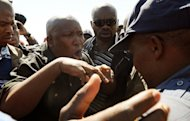 South African police bar firebrand Julius Malema (L) from addressing around 2,000 striking workers at the strife-torn Lonmin Marikana on September 17, 2012. Rabble-rousing Malema, who was axed from the ruling ANC party, has grabbed the spotlight of South Africa's mining unrest with calls for wildcat stoppages