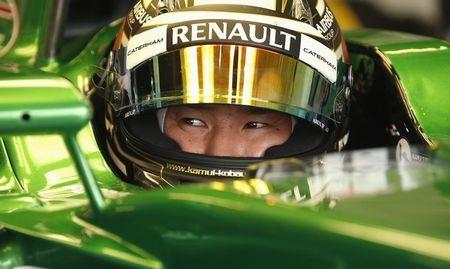 Caterham Formula One driver Kobayashi of Japan sits in his car during second practice ahead of the British Grand Prix at the Silverstone Race Circuit, central England