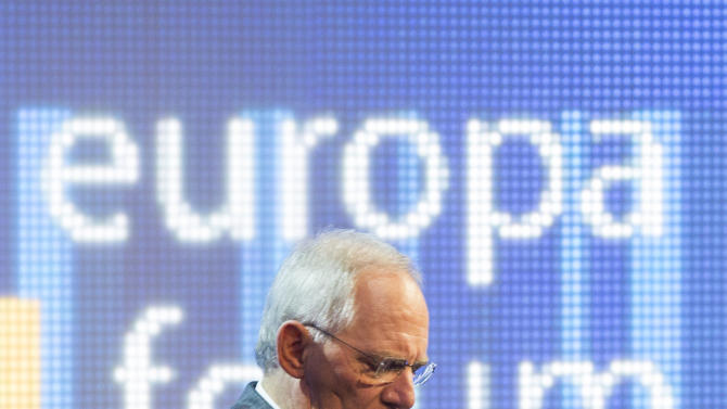 German Finance Minister Wolfgang Schaeuble adjusts his jacket before a panel discussion of the Europe forum conference, organized by German public-broadcasting institution WDR, in Berlin, Germany, Thursday, May 16, 2013. (AP Photo/Gero Breloer)