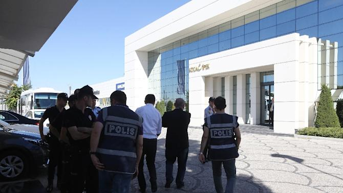 Turkish police officers at the Koza Ipek Holding building in Ankara on September 1, 2015, after they staged a major swoop on the media group critical of President Recep Tayyip Erdogan