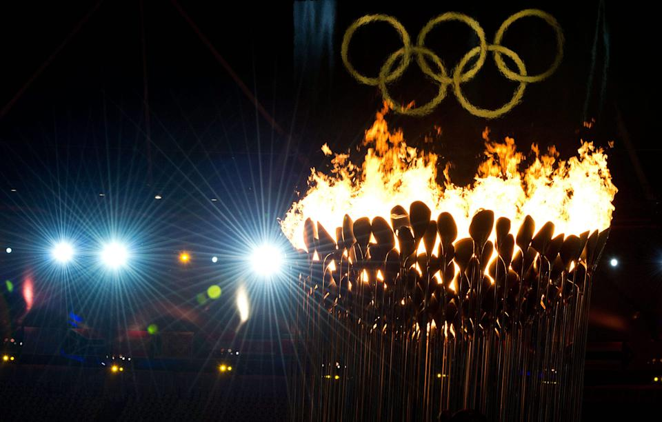 The Olympic cauldron burns following the opening ceremonies for the 2012 Summer Olympics in London on Saturday, July 28, 2012. (AP Photo/The Canadian Press, Sean Kilpatrick)