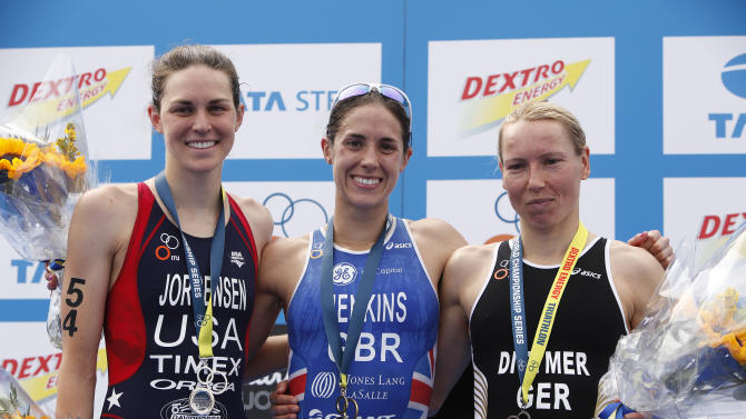 Helen Jenkins of Britain, centre, winner with Gwen Jorgensen of the U.S., second and Anja Dittmer of Germany, third, pose for photographers at the medal ceremony for the women's ITU World Championship Triathlon race in London, Saturday, Aug., 6, 2011. (AP Photo/Alastair Grant)