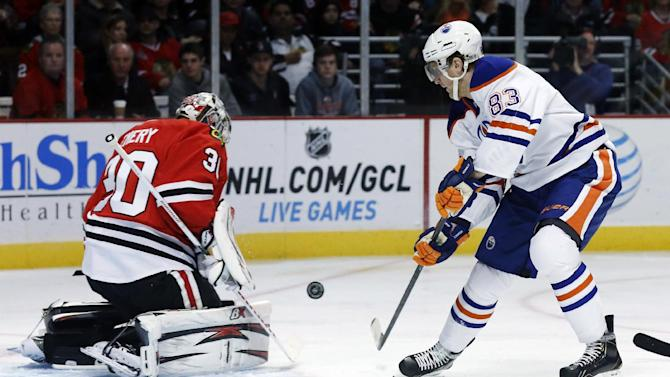 Chicago Blackhawks goalie Ray Emery (30) makes a save on a shot by Edmonton Oilers right wing Ales Hemsky, of the Czech Republic, during the first period of an NHL hockey game, Monday, Feb. 25, 2013, in Chicago. (AP Photo/Charles Rex Arbogast)