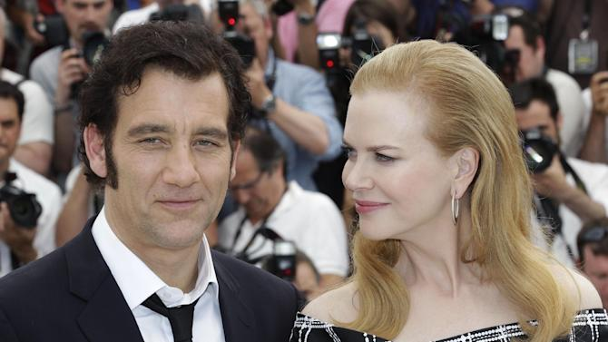 Actors Nicole Kidman, right, and Clive Owen pose for photographers during a photo call for Hemmingway and Gellhorn at the 65th international film festival, in Cannes, southern France, Friday, May 25, 2012. (AP Photo/Lionel Cironneau)