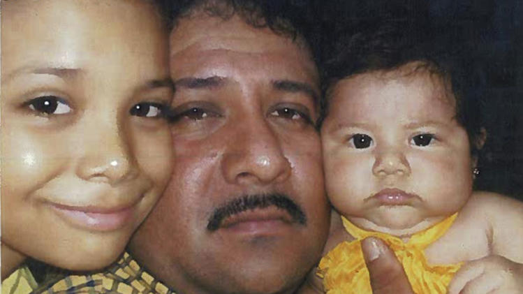 This photo dated in 2007 from federal court documents provided by attorneys for Jose Gonzales-Zavala shows Gonzales-Zavala with two of his children allegedly taken in Mexico. Prosecutors say Gonzales-Zavala was a member of the La Familia cartel, based in southwestern Mexico, and dispatched to the Chicago area to oversee one of the cartel's lucrative trafficking cells. His defense team entered the photograph into evidence during the sentence stage of his case in arguing for leniency. In 2011, he was sentenced to 40 years in prison by a federal judge in Chicago. (AP Photo/Attorneys for Jose Gonzales-Zavala)