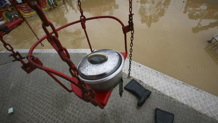 A rice cooker is seen at a fun fair surrounded by floodwaters at Chenor, between the border state of Pahang and Terengganu