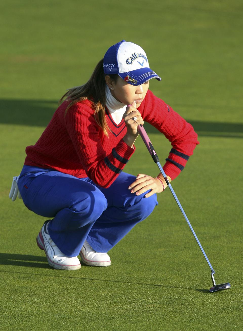 Japan's Momoko Ueda judges her putt on the first during the first round of the Women's British Open at Carnoustie Golf Club, Carnoustie, Scotland, Thursday July 28, 2011.(AP Photo/Scott Heppell)