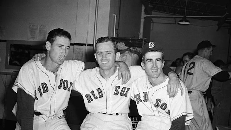 FILE - In this Sept. 25, 1949, file photo, Boston Red Sox pitcher Mel Parnell, center, is flanked by teammates Ted Williams, left, and Johnny Pesky after defeating the New York Yankees 4-1 in a baseball game at Fenway Park in Boston. Pesky, who spent most of his 60-plus years in pro baseball with the Red Sox and was beloved by the team's fans, has died on Monday, Aug. 13, 2012, in Danvers, Mass. He was 92. (AP Photo, File)