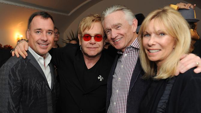 """From left, David Furnish, Elton John, Ian Telfer and Nancy Burke attend LoveGold/EJAF Celebrate """"How to Survive a Plague"""" at Chateau Marmont on February 22, 2013 in Los Angeles. (Photo by Jordan Strauss/Invision for LoveGold/AP Images)"""