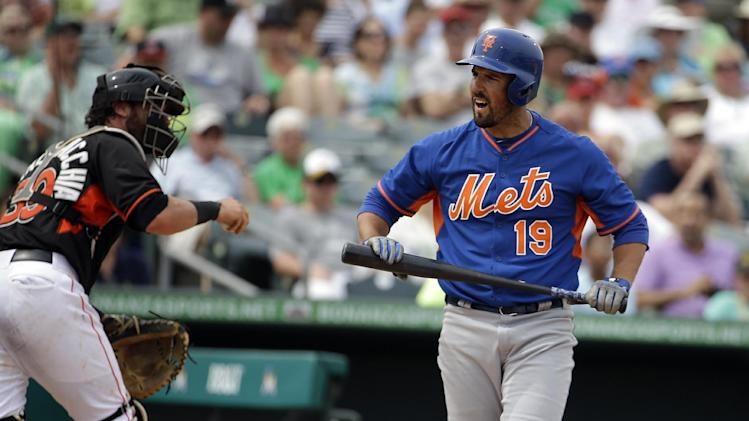 New York Mets' Zach Lutz, right, reacts after striking out in an exhibition spring training baseball game against the Miami Marlins, Monday, March 17, 2014, in Jupiter, Fla. (AP Photo/David Goldman)