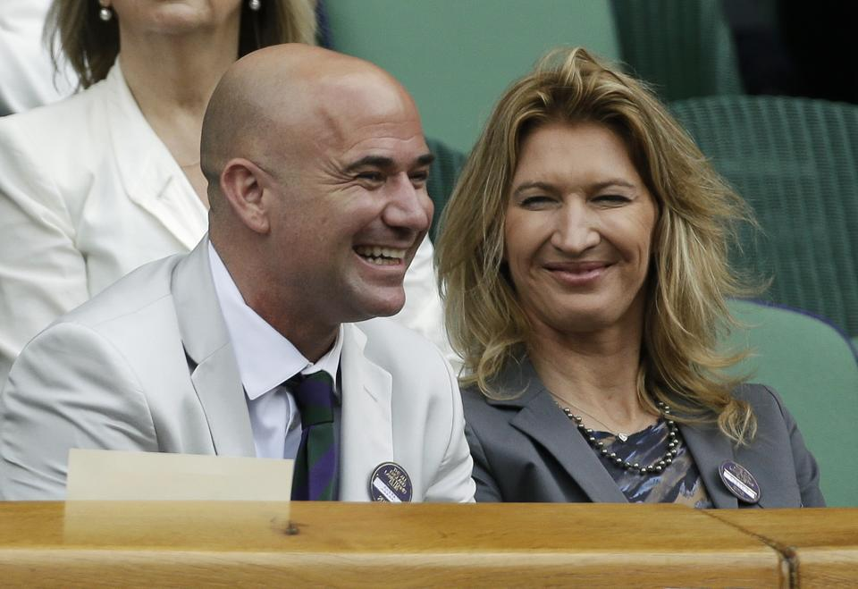 Retired tennis players Andre Agassi, left, and Steffi Graf attend a quarterfinals match between Mikhail Youzhny of Russia and Roger Federer of Switzerland at the All England Lawn Tennis Championships at Wimbledon, England, Wednesday July 4, 2012. (AP Photo/Anja Niedringhaus)
