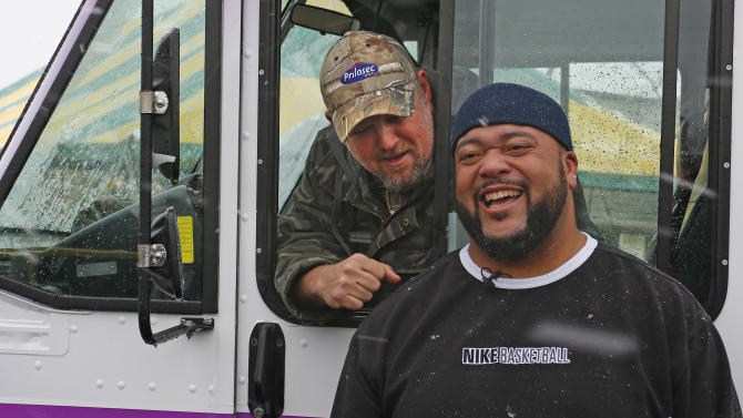 IMAGE DISTRIBUTED FOR PRILOSEC OTC - Frequent heartburn sufferer and comedian Larry the Cable Guy and former nose tackle Gilbert Brown roll into Green Bay to promote new Prilosec OTC Wildberry and encourage fans to enter the Wild American Flavor Sweepstakes at www.wildberryflavor.com, on Sunday, Dec. 9, 2012 in Green Bay, Wis. (Photo by Matt Ludtke/Invision for Prilosec OTC/AP Images)