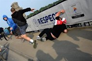 Poland and Russian fans fight each other in Warsaw on June 12, 2012, ahead of the Euro 2012 championships football match Poland vs Russia. Police used water cannon and tear gas on unruly Euro 2012 fans in Warsaw today as Poland geared up to play old foe Russia in a must-win Euro 2012 match.       AFP PHOTO / DIMITAR DILKOFF