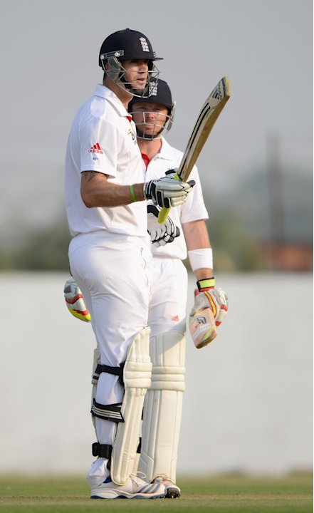 Kevin Pietersen of England raises his bat after reaching his century during the tour match between England and Haryana at Sardar Patel Stadium ground B on November 8, 2012 in Ahmedabad, India. (Photo