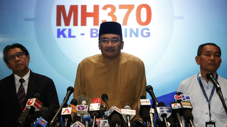 Malaysia's acting Transport Minister Hishammuddin Tun Hussein listens during news conference about missing Malaysia Airlines flight MH370, at Kuala Lumpur International Airport