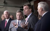 Sen. Mark Warner, D-Va., second from right, accompanied by House Minority Whip Steny Hoyer of Md., right, and others, gestures during a news conference on Capitol Hill in Washington, Wednesday, Nov. 16, 2011. (AP Photo/Carolyn Kaster)