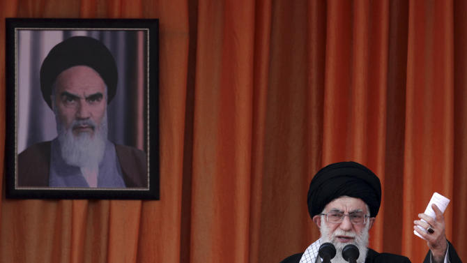 "In this photo released by an official website of the Iranian supreme leader's office, Iranian supreme leader Ayatollah Ali Khamenei, speaks at a public gathering on his tour to the northeastern city of Bojnourd, Iran, Wednesday, Oct. 10, 2012. Iran's top leader said Wednesday that European countries are ""foolish"" to support sanctions against Tehran, telling them they are sacrificing themselves for the sake of the United States. A picture of late Iranian revolutionary founder Ayatollah Khomeini hang at rear.  (AP Photo/Office of the Supreme Leader)"