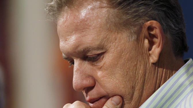 John Elway, the Denver Broncos executive vice president of football operations, considers questions about his team's loss to the Blatimore Ravens in an AFC Playof game, during a news conference at the team's headquarters in Englewood, Colo., on Monday, Jan. 14, 2013. (AP Photo/David Zalubowski)